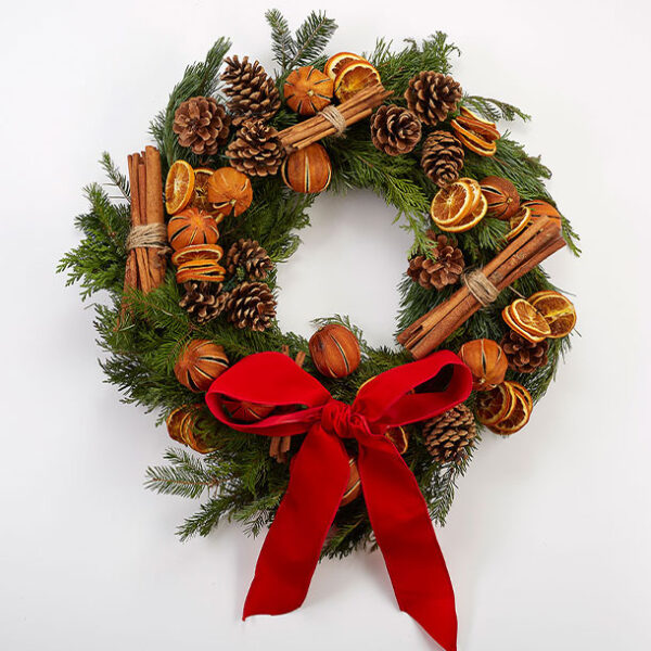St Nicholas Christmas Wreath red bow cinnamon cloves
